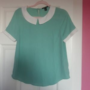Teal shirt with white collar